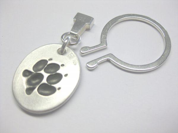 """Schlüsselanhänger """"Hundepfote"""" aus 925 Silber"""