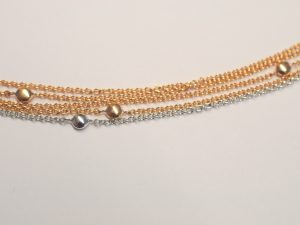 Armband Rotgold/Weißgold aus 5 Ankerkettchen